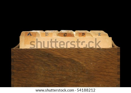 A small wooden container meant for holding recipes. This can also be seen as an indexed file cabinet. - stock photo