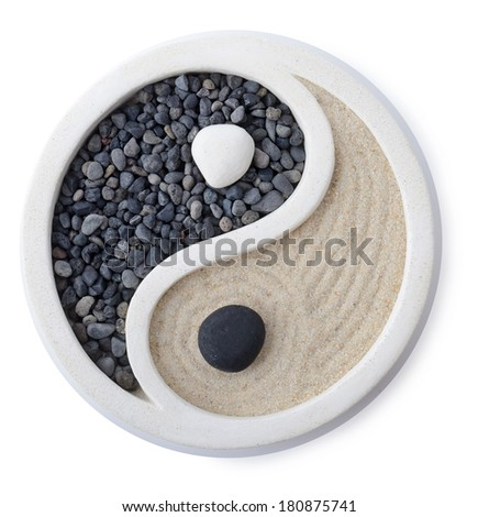 a small zen garden ying yang symbol isolated on white - stock photo