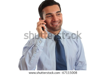 A smart happy businessman in conversation on  a mobile phone cellphone. White background. - stock photo
