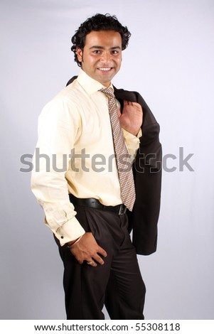 A smart Indian businessman carrying his coat. - stock photo
