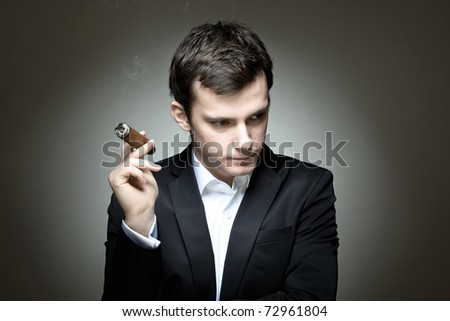 A smart young man successful in business - stock photo