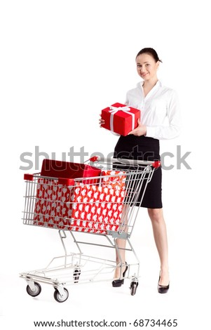 A smartly dressed woman shopping for gifts looking at her watch - late. - stock photo