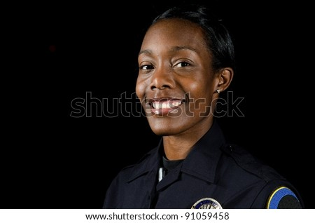 a smile African-American Police officer working the night shift. - stock photo