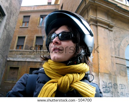 a smiley girl rides a scooter with a helmet and sunglasses - stock photo