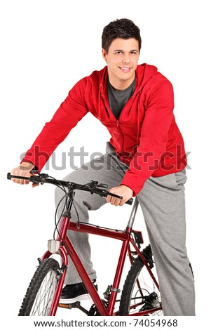 A smiling bicyclist on a bicycle posing isolated on white background - stock photo