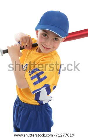A smiling boy with a baseball or t-ball bat and uniform.  White background. - stock photo