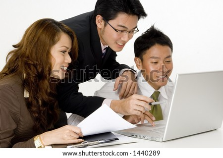 A smiling business group of young asian executives - stock photo