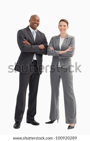 A smiling business man and woman are posing