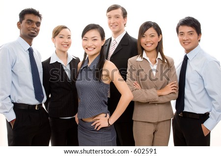 A smiling business team of different ethnicities - stock photo