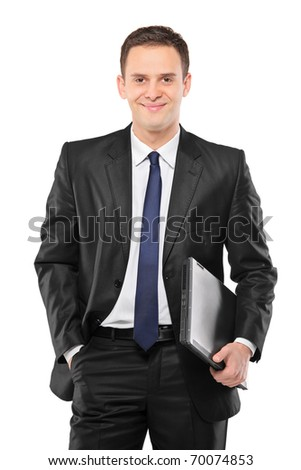 A smiling businessman holding a laptop isolated against white background - stock photo