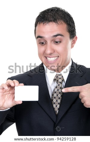 A smiling businessman holds out a credit card on white background - stock photo