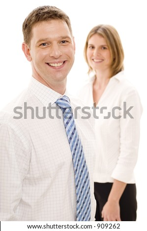 A smiling businessman standing in front of a female colleague