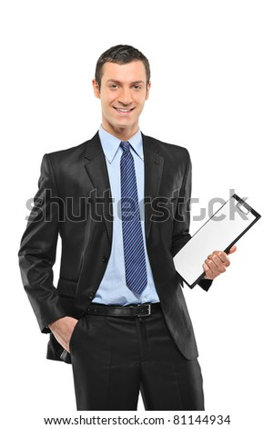 A smiling businessperson holding a blank clipboard isolated against white background - stock photo