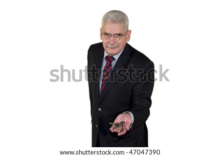 a smiling caucasian senior manager offering a key as symbol for success, isolated on white background