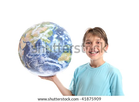 A smiling, cheerful boy student holding the world earth in the palm of his hand.