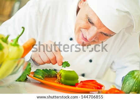 A smiling cook preparing a delicious dish.