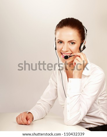 A smiling customer service girl isolated on white background