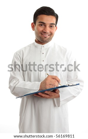 A smiling ethnic businessman writing on a clipboard folder - stock photo