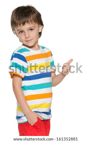 A smiling fashion little boy in blue shirt holding his thumb up and back on the white background - stock photo