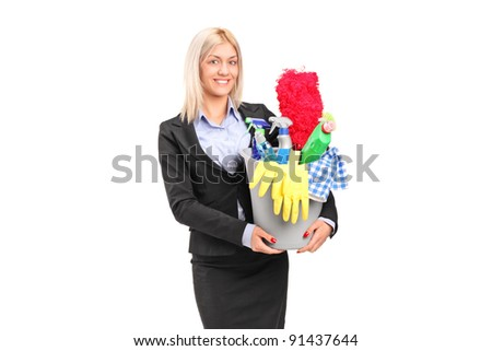 A smiling female holding a bucket full of cleaning supplies isolated on white background - stock photo