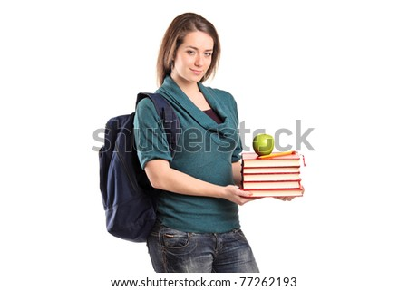 A smiling female student holding books and an apple isolated on white background - stock photo