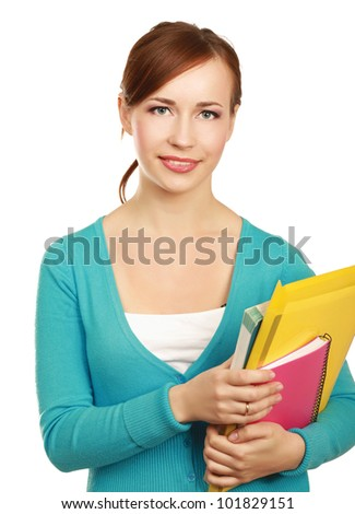 A smiling female student holding books isolated on white background - stock photo