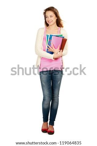 A smiling female student holding books isolated on white background - stock photo