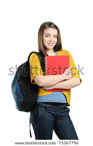 A smiling female student with a school bag holding a book isolated on white background - stock photo