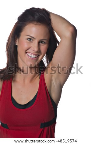 A smiling, fit female athlete - stock photo