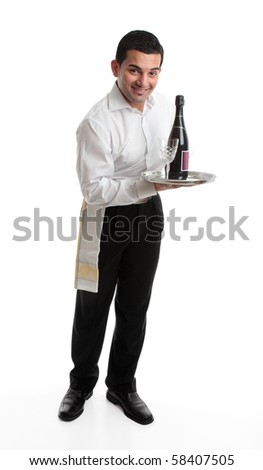 A smiling friendly waiter, bartender, or domestic staff, holding or presenting a tray with a bottle of  wine and glasses.  White background. - stock photo