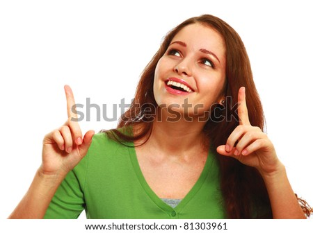 A smiling girl looking, pointing up - on white background