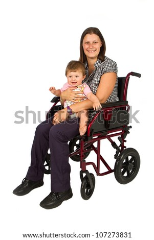 A smiling girl with a baby  in a wheelchair isolated on white background - stock photo