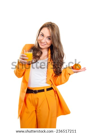 a smiling girl with a glass of juice and tangerine - stock photo
