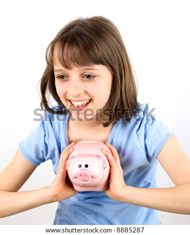 A smiling girl with a piggy bank