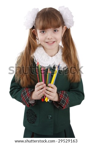 A smiling girl with color pencils in hands on a white background. Schoolgirl is holding coloured pencils. - stock photo