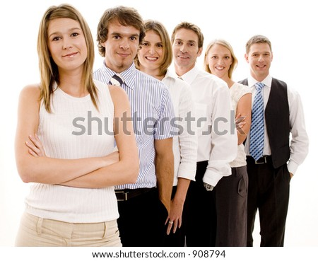 A smiling group of business people in a line (Shallow depth of field used) - stock photo