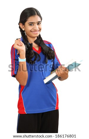 A smiling Indian female student holding books isolated on white background - stock photo