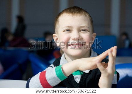 A smiling little boy in kindergarten