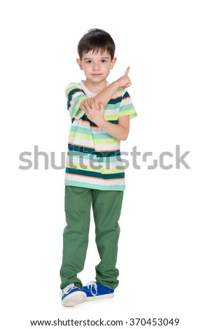 A smiling little boy shows his finger back - stock photo