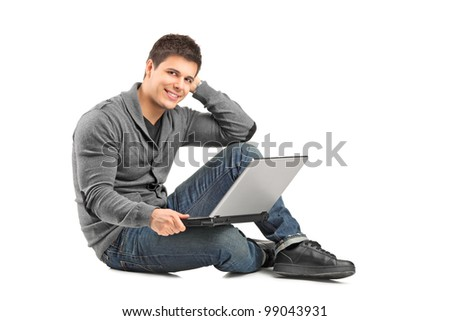 A smiling male with a laptop looking at camera isolated on white background
