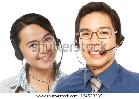 A smiling man and woman wearing headsets