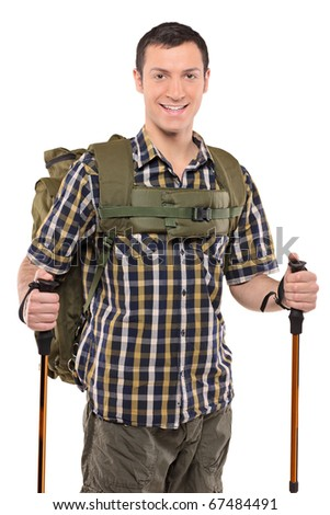 A smiling man in sportswear with backpack and hiking poles isolated on white background - stock photo