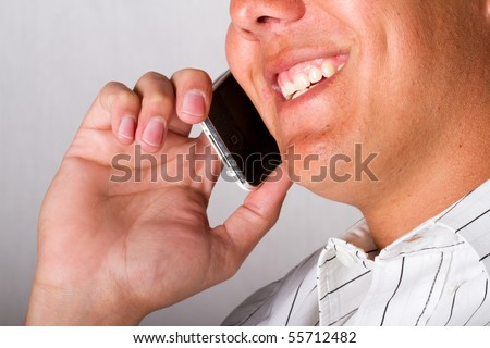 A smiling man on a mobile phone - stock photo