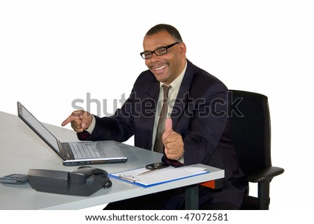 a smiling mature African-American businessman pointing at his laptop and posing with the thumbs up, isolated on white background - stock photo