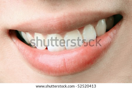 a smiling mouth of an attractive lady