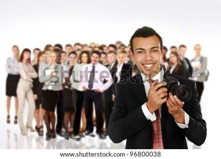 A smiling professional photographer and group people - stock photo