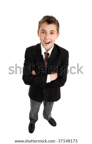 A smiling school boy wearing uniform.  He is standing on white background. - stock photo