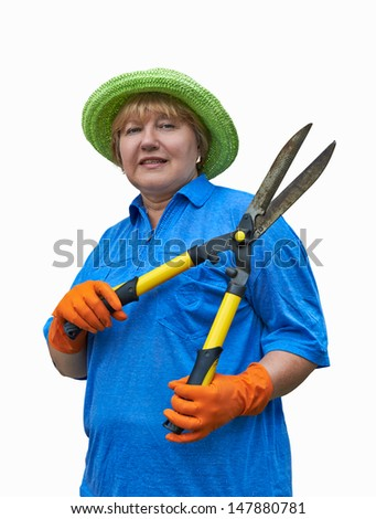 A smiling senior woman holding in hands garden shears. Image is isolated on white. - stock photo