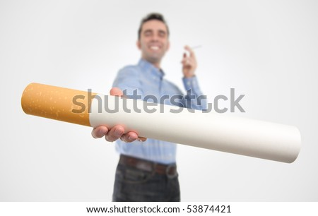 "A smiling smoker (out of focus) offers a giant cigarette (in focus), probably to somebody who quit smoking/shouldn't smoke. The big size of the cigarette equals the intensity of the ""tobacco craving"". - stock photo"