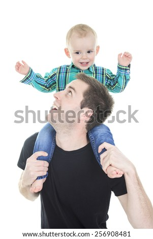 A Smiling  son on the shoulders his father isolated on white background - stock photo